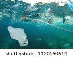 plastic pollution in ocean.... | Shutterstock . vector #1120590614