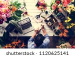 business owner in flower shop | Shutterstock . vector #1120625141