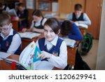 elementary school students... | Shutterstock . vector #1120629941