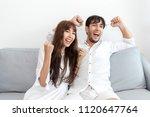 couple football fans cheer... | Shutterstock . vector #1120647764