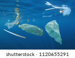 plastic ocean pollution.... | Shutterstock . vector #1120655291