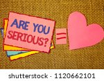Small photo of Writing note showing Are You Serious Question. Business photo showcasing Have to be kidding me Disbelief Is it for real Pink yellow blue notes black red letters ideas equal sign heart wicker.