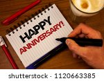 Small photo of Word writing text Happy Anniversary Motivational Call. Business concept for Annual Special Milestone Commemoration Hand grasp black marker wooden desk red pen notepad expos texts coffee.