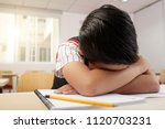 schoolboy crying or sleeping at ... | Shutterstock . vector #1120703231