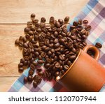 coffee beans and cup on the... | Shutterstock . vector #1120707944