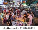 Small photo of BANGKOK, MARCH 11: Tourists haggle with a Pad Thai vendor on Bangkok's Khao San Road on March 11, 2018.