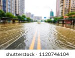 streets inundated by heavy rain ... | Shutterstock . vector #1120746104