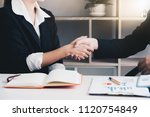 estate agent shaking hands with ... | Shutterstock . vector #1120754849