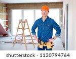 portrait of smiling handyman... | Shutterstock . vector #1120794764
