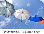 colorful umbrellas background... | Shutterstock . vector #1120845704