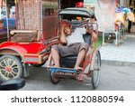 a bicycle riksha taxi at the... | Shutterstock . vector #1120880594