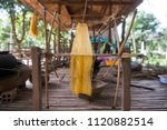 a silk production at the silk... | Shutterstock . vector #1120882514