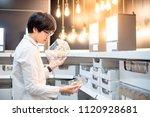 young asian man choosing...   Shutterstock . vector #1120928681