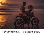 seductive couple cuddling on... | Shutterstock . vector #1120951409
