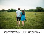 outdoor shot of young couple... | Shutterstock . vector #1120968437