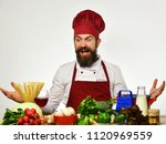 cook with shocked face in... | Shutterstock . vector #1120969559