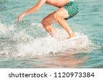 closeup of skimboarder  riding...   Shutterstock . vector #1120973384