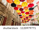 lot of umbrellas in petit... | Shutterstock . vector #1120979771