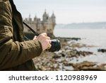 a professional photographer or... | Shutterstock . vector #1120988969
