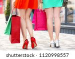 young women with shopping bags... | Shutterstock . vector #1120998557