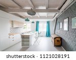 open bright kitchen with white... | Shutterstock . vector #1121028191