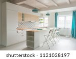 open bright kitchen with white... | Shutterstock . vector #1121028197