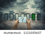 hands hold a sheet with...   Shutterstock . vector #1121035637
