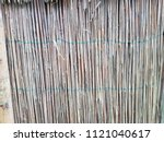 the texture of the dry reeds....   Shutterstock . vector #1121040617