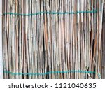 the texture of the dry reeds.... | Shutterstock . vector #1121040635
