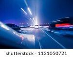 modern urban road traffic in... | Shutterstock . vector #1121050721