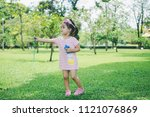 a little girl happy and walk in ... | Shutterstock . vector #1121076869
