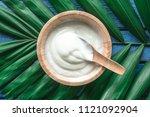 top view of yogurt in wooden... | Shutterstock . vector #1121092904
