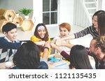 multiethnic young team stack... | Shutterstock . vector #1121135435