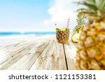 fresh pineapple and summer time.... | Shutterstock . vector #1121153381