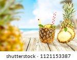 fresh pineapple and summer time.... | Shutterstock . vector #1121153387