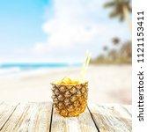 fresh pineapple and summer time.... | Shutterstock . vector #1121153411