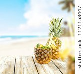 fresh pineapple and summer time.... | Shutterstock . vector #1121153447