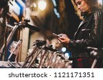 young girl in black leather... | Shutterstock . vector #1121171351