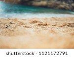 coastline beach on sunny day... | Shutterstock . vector #1121172791