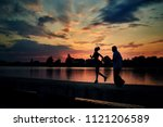 Small photo of Dark silhouettes of running girl and senior man while sunset near lake. Fitness, crossfit exercises. Fit, strong bodies, healthy lifestyle. Outdoors workout on fresh air. Evening's scamper.