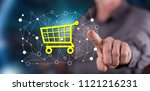 man touching an e commerce... | Shutterstock . vector #1121216231