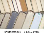 close up of a row of vintage books - stock photo