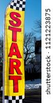 Small photo of A yellow and red start sign is blowing in the wind at the start of a 5K road race.