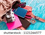 backpack with stuff. travel... | Shutterstock . vector #1121266577