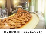 cakes on automatic conveyor... | Shutterstock . vector #1121277857