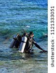 divers go to sea. egypt dahab   Shutterstock . vector #1121333051