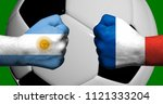 Flags of Argentina and France painted on two clenched fists facing each other with closeup 3d soccer ball in the background/Mixed media football match concept