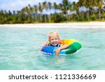 child with inflatable ring on... | Shutterstock . vector #1121336669