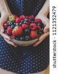 organic fresh harvested berries.... | Shutterstock . vector #1121352479