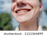 young girl smiles and shows... | Shutterstock . vector #1121364899